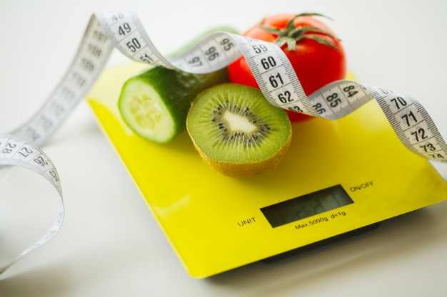 diet-fruits-vegetables-with-measuring-tape-weight-scale_118454-3598