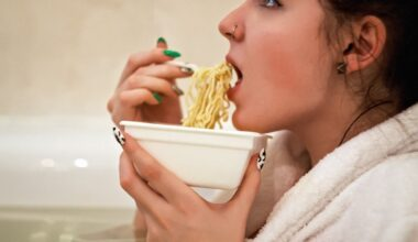 A girl eating instant noodles